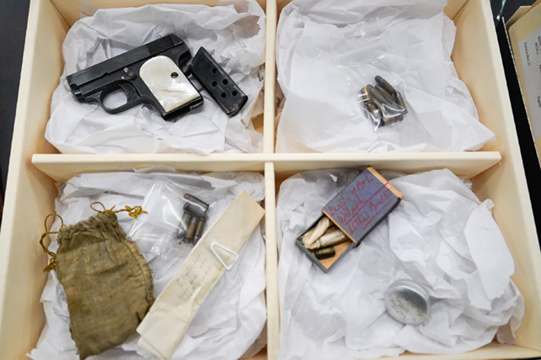 Gun, bullets and other evidence in the collection