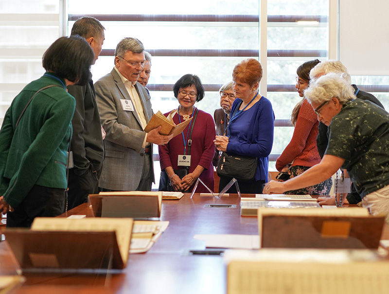 John Shepard, Curator of Music Collections, third from left, talks about a rare collection of books during a luncheon for the Library Legacy Circle at the Music Library on Feb. 10, 2018. (Photos by Cade Johnson for the UC Berkeley Library)
