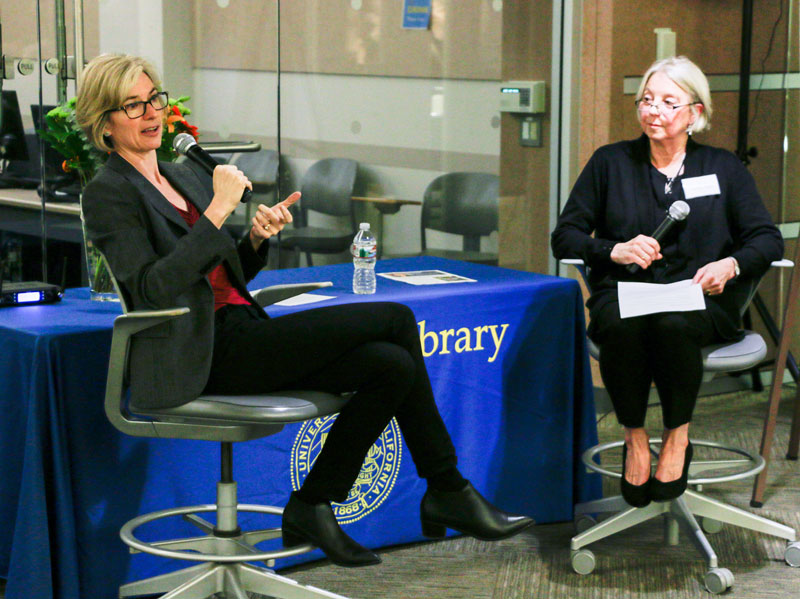 Jennifer Doudna, left, professor and co-inventor of CRISPR-Cas9 gene editing, speaks with Susan Koskinen, head of the Life and Health Sciences Library Division, at the Bioscience & Natural Resources Library on Nov. 14, 2017. (Photo by J. Pierre Carrillo for the University Library)