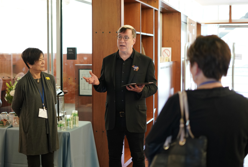 Jeffrey MacKie-Mason, University Librarian, center, welcomes donors to the Library Legacy Circle luncheon at the Music Library on Feb. 10, 2018.