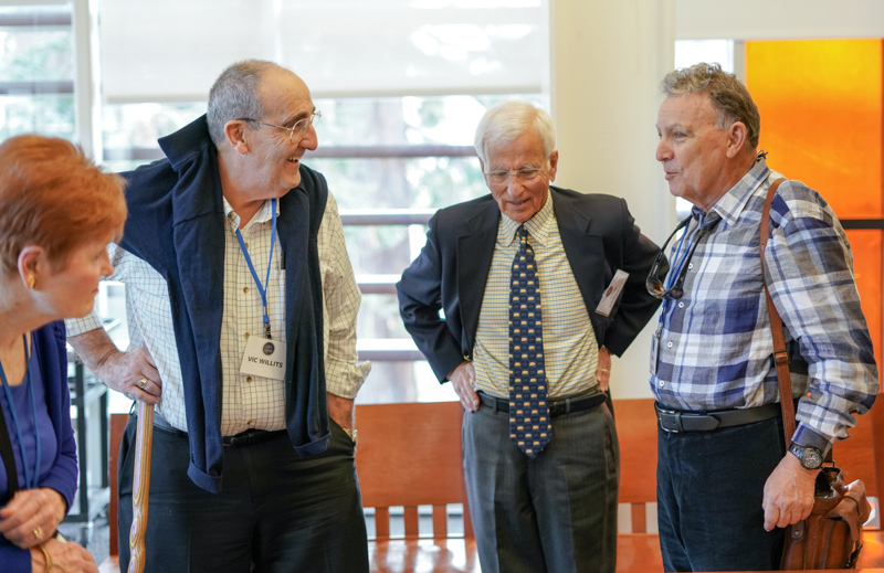 Left to right: Dr.​ ​Victor W. Willits '62, Ed.D. '68, Col.​ ​Don E. Kosovac '58, ​and ​Mark W. Jordan J.D. '66 chat at the event.