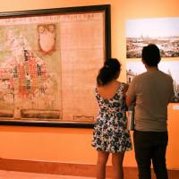 Visitors look at photographs near an 1807 map of Mexico City on Oct. 27.