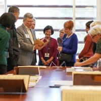John Shepard, curator of music collections, third from left, talks about a rare collection of books during a luncheon for the Library Legacy Circle at the Music Library on Feb. 10, 2018. (Photos by Cade Johnson for the University Library)