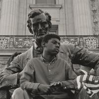 David Johnson photograph of a boy sitting on a statue of Abraham Lincoln