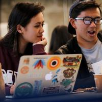 Kim Do, left, and Jed Lee participate in the Wikipedia Edit-a-Thon event at Moffitt Library on March 6, 2018. (Photo by J. Pierre Carrillo for the UC Berkeley Library)