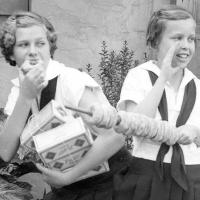 Camp Fire Girls selling donuts in 1934