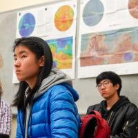 Students listen to speaker at Maps and More event.