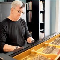 University Librarian plays piano